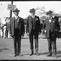 Image of three men standing at the New England Fair