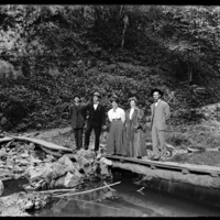 Mabel Wohlbrück and others standing on a wooden bridge