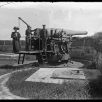 Mabel Wohlbrück standing on a cannon
